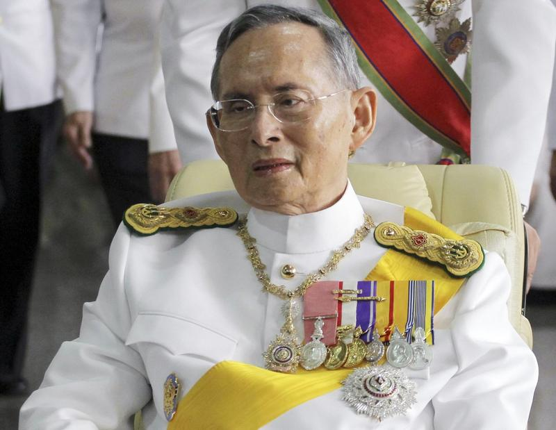 In this Dec. 5, 2011, file photo, Thailand's King Bhumibol Adulyadej is pushed on a wheelchair while leaving Siriraj hospital for the Grand Palace for a ceremony celebrating his birthday in Bangkok. (Apichart Weerawong/AP)