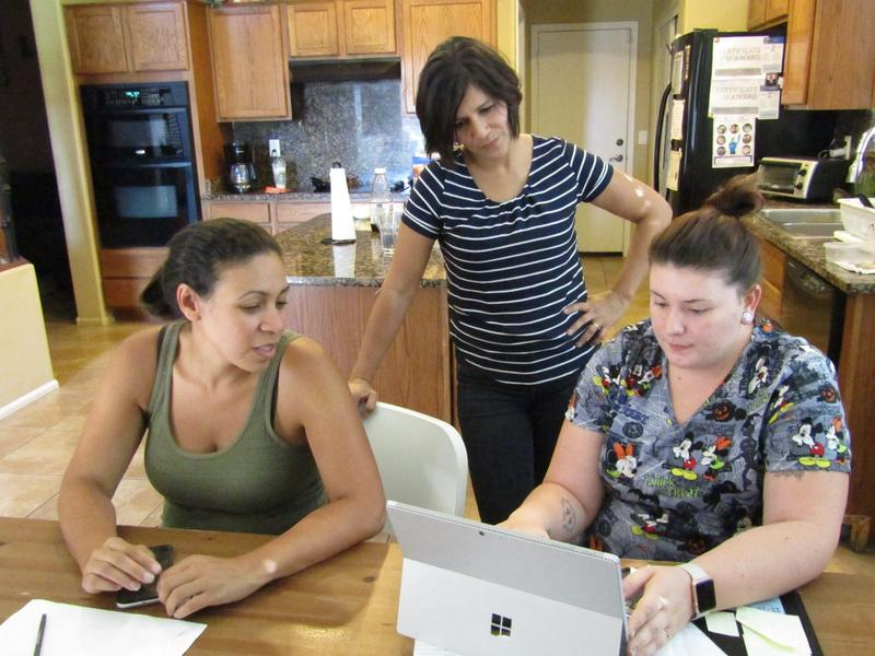 Jennifer Redmond (left, in green shirt) runs a group home for LGBT teens in Arizona. (Casey Kuhn/KJZZ)