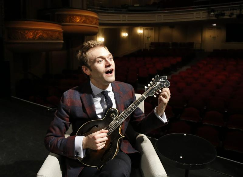"""Chris Thile at the Fitzgerald Theater in St. Paul, Minn. Thile is replacing Garrison Keillor as host of """"A Prairie Home Companion"""" after Keillor retired this summer. (Ann Heisenfelt/AP)"""