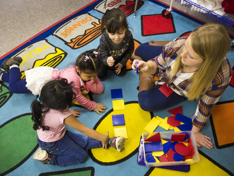 Teacher Sarah Ross and students (from left to right) Ximena, age 4, Yareli, age 3, and Kendra, age 2 at the Indiana Migrant Preschool Center, a free preschool for migrant children ages 2 to 5. The school teaches students in English and Spanish with the goal of preparing migrant children for kindergarten, wherever it may be.
