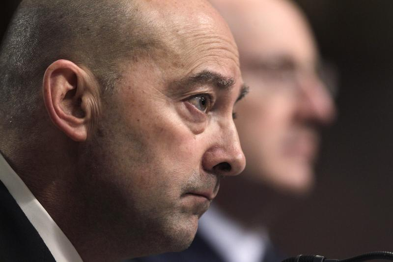 Retired Navy Admiral and NATO's former Supreme Allied Commander James G. Stavridis, left, and retired Air Force General and former commander of the U.S. Strategic Command C. Robert Kehler testify on Capitol Hill in Washington on Tuesday, March 29, 2011, before the Senate Armed Services Committee hearing on the U.S. mission in Libya. (J. Scott Applewhite/AP)