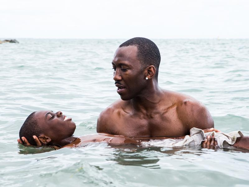Juan (played by Mahershala Ali) teaches Chiron (Jaden Piner) how to swim in <em>Moonlight</em>. The film is told with different actors playing Chiron at different stages of his life.