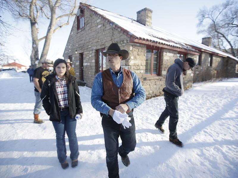 Ryan Bundy (center) walks through the Malheur National Wildlife Refuge near Burns, Ore., on Jan. 8.