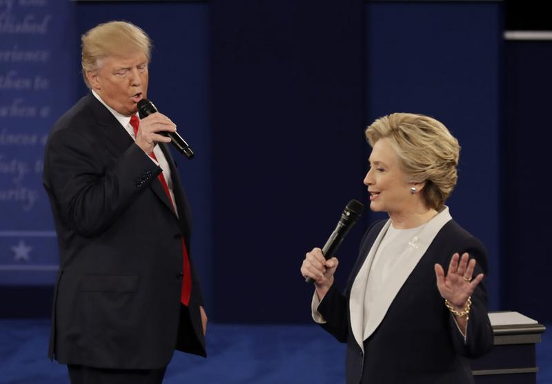 In this Sunday, Oct. 9, 2016, file photo, Republican presidential nominee Donald Trump and Democratic presidential nominee Hillary Clinton speak during the second presidential debate at Washington University in St. Louis. (Patrick Semansky/AP)