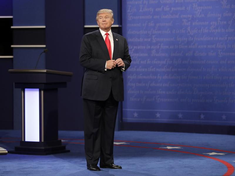 Republican presidential nominee Donald Trump stands on stage after the third presidential debate at UNLV in Las Vegas on Wednesday.