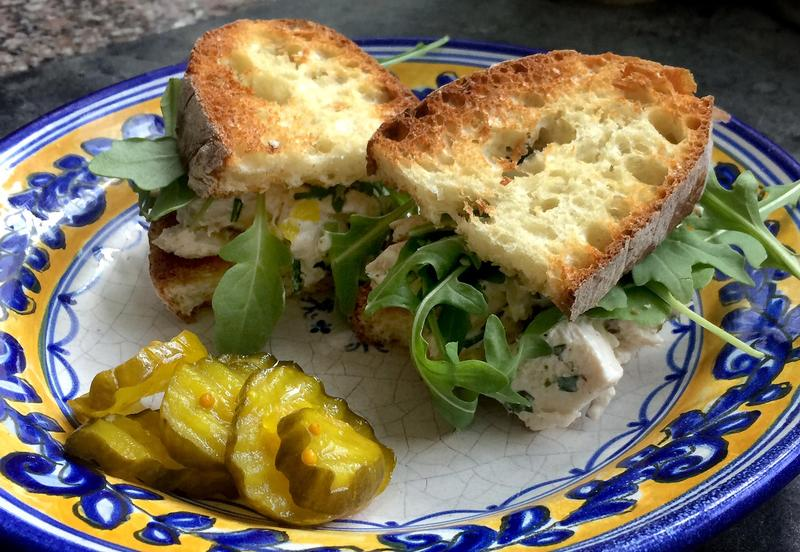 Kathy's chicken salad sandwich with arugula and pickles. (Kathy Gunst for Here & Now)
