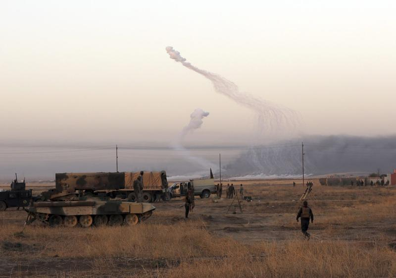 Smoke rises in nearby Mosul as Iraq's elite counterterrorism forces advance towards the city in Iraq, Thursday, Oct. 20, 2016. (Khalid Mohammed/AP)