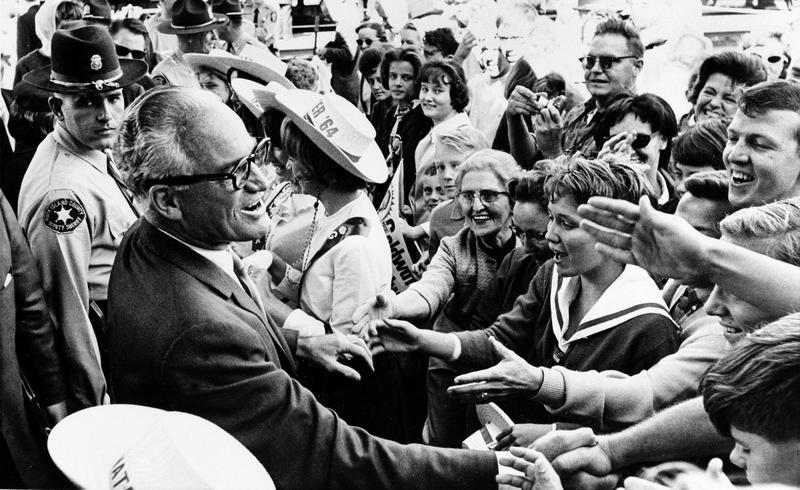 Republican presidential candidate Barry Goldwater greets supporters during a whistle-stop tour of Rock Island, Ill., on Oct. 3, 1964. (Henry Burroughs/AP)