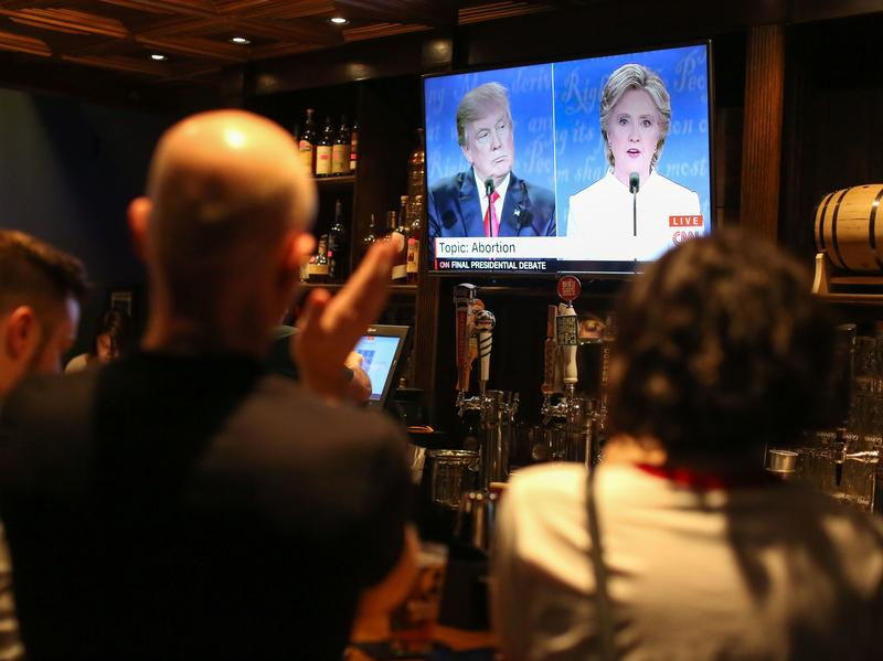 People watch the third presidential debate between Hillary Clinton and Donald Trump at Murphy's Tap House in uptown Charlotte, N.C.