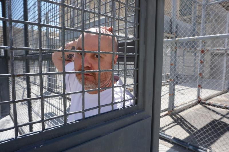 Death row inmate Joseph Perez in a San Quentin exercise cage. He was sentenced to death for helping to kill a Contra Costa County housewife with two others in 1998. Perez denies his guilt, but is afraid he'll die at San Quentin, if not from execution than old age. (Saul Gonzalez/KCRW)