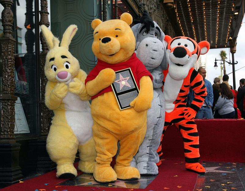(L-R) Rabbit, Winnie The Pooh, Eeyore and Tigger pose for photos as Winnie The Pooh receives a star on the Hollywood Walk of Fame in front of the El Capitan Theatre on April 11, 2006 in Los Angeles. (Michael Buckner/Getty Images)