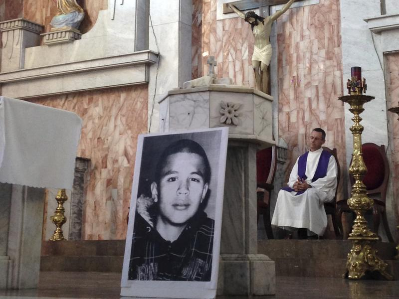 A photo of Jose Antonio Elena Rodriguez, who was fatally shot by a U.S. Border Patrol  near the Mexico-U.S border, rests on a church altar during a memorial mass in Nogales, Sonora, Mexico. A federal appeals court heard arguments on whether his family can file a civil lawsuit in U.S. courts.