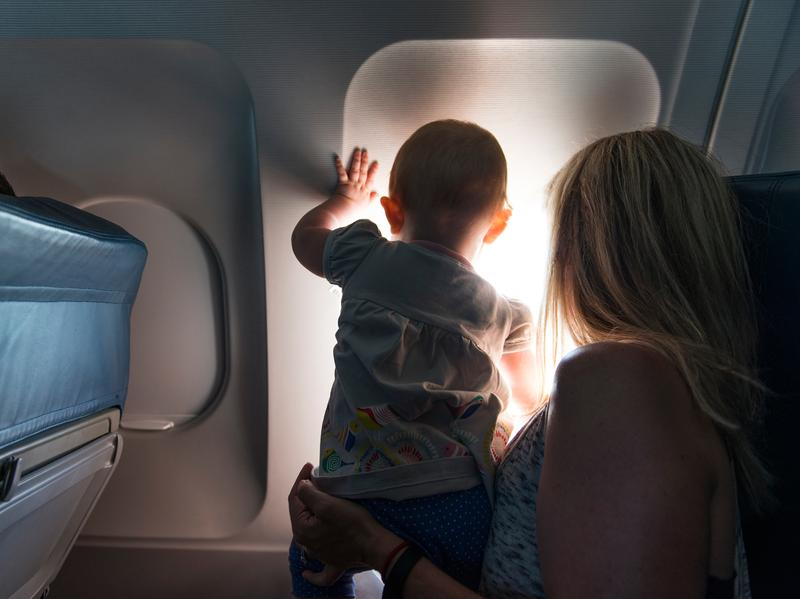 The window seat may be a safer spot for small children than along the aisle. Plus there's the view.