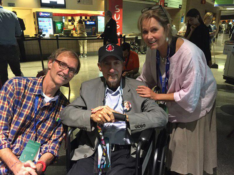 Here & Now producer Alex Ashlock (left) and host Robin Young (right) spoke with Tom Hayden at the 2016 Democratic National Convention. (Robin Young/Here & Now)