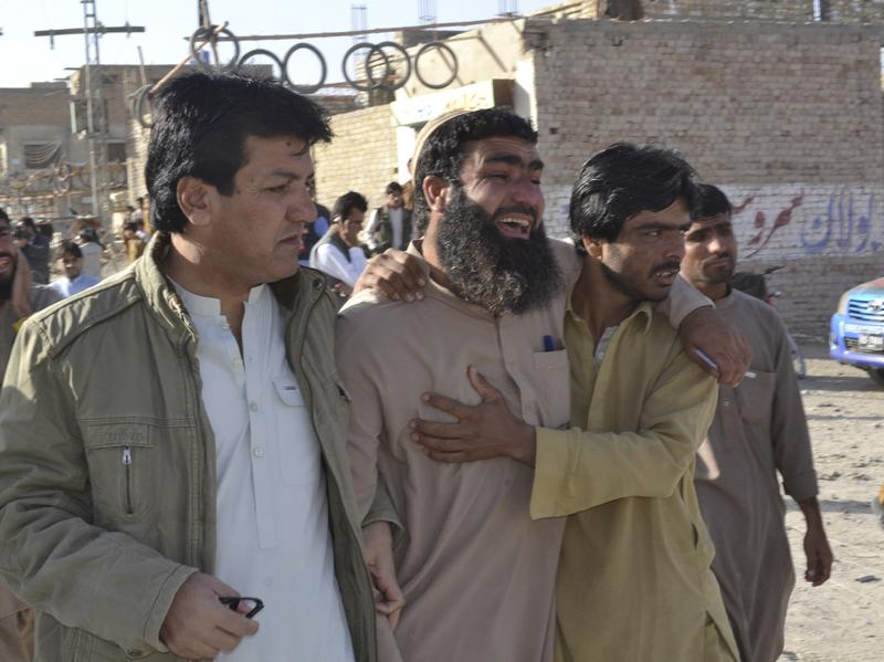 Pakistani family members of victims visit a police training center in Quetta, Pakistan, on Tuesday after gunmen opened fire and detonated explosive vests in an hourslong siege of the academy. Scores of people were killed, mostly young police cadets.