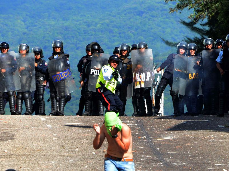 Riot police confront students opposed to President Nicolas Maduro's government in San Cristobal, Venezuela, on Monday. Pope Francis met with Maduro on Monday night to discuss the crisis in Venezuela.