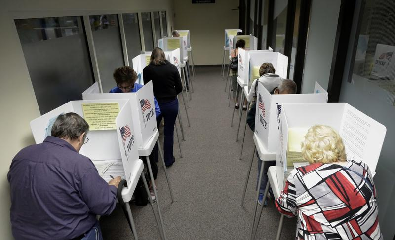 Voters cast their ballots at the Santa Clara County Registrar of Voters on Monday, Oct. 24, 2016, in San Jose, Calif. (Marcio Jose Sanchez/AP)