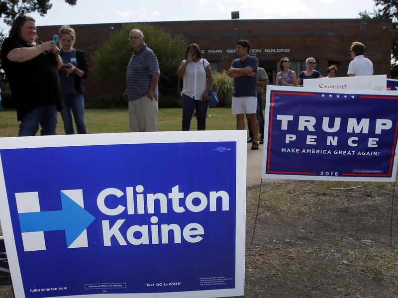 Voters wait in line to cast their ballots at in Dallas on Thursday.