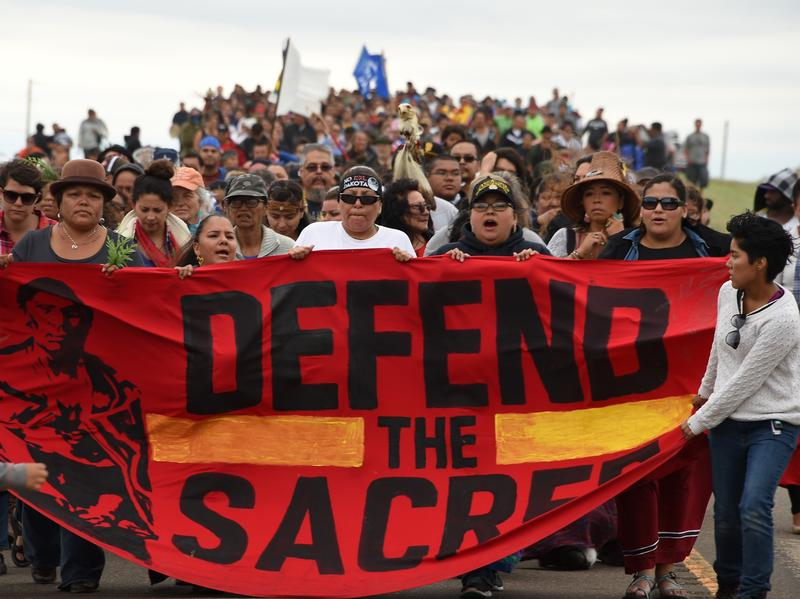 Native Americans march to a sacred burial ground site that was disturbed by bulldozers building the Dakota Access Pipeline in North Dakota, where hundreds of people have gathered to join the Standing Rock Sioux Tribe's protest.