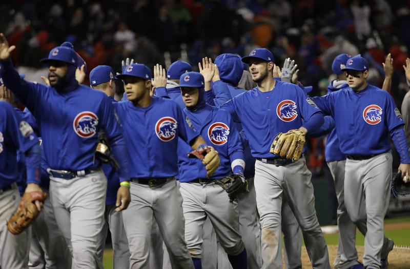 The Chicago Cubs celebrate after Game 2 of the Major League Baseball World Series against the Cleveland Indians Wednesday, Oct. 26, 2016, in Cleveland. (David J. Phillip/AP)