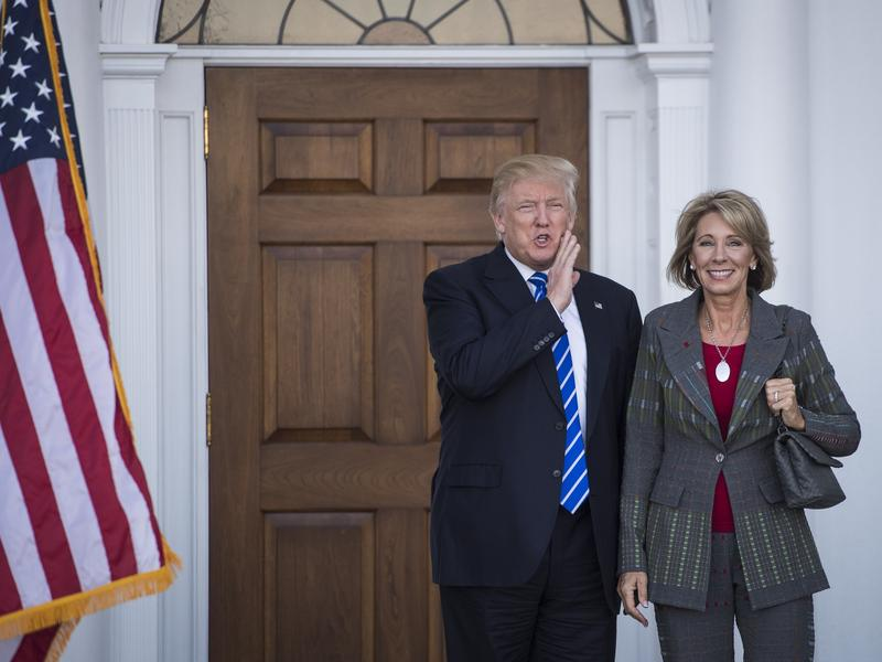 President-elect Donald Trump stands with Betsy DeVos after a meeting at Trump National Golf Club Bedminster in Bedminster Township, N.J., on Saturday.