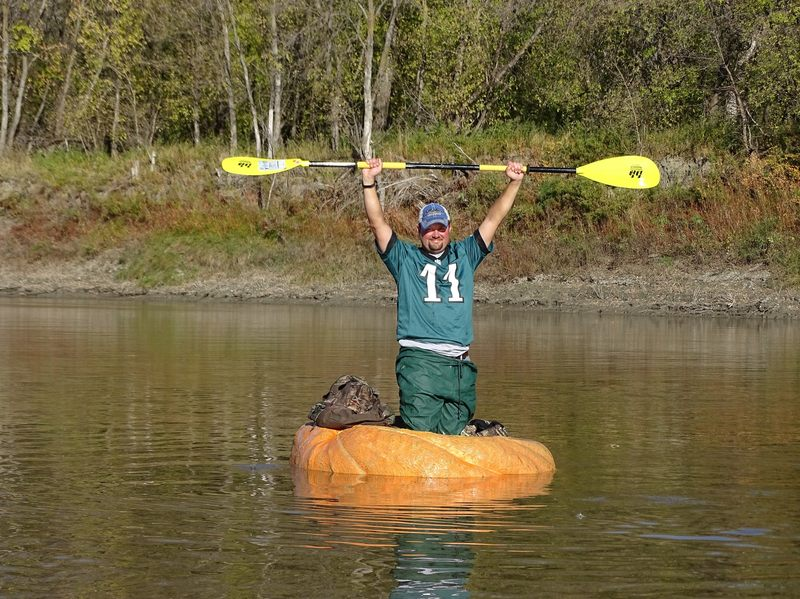 Rick Swenson, triumphant in his pumpkin. This photograph was taken when he unofficially broke the record at mile 15.2.