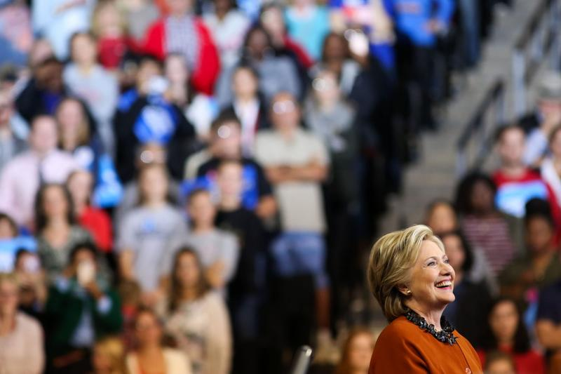 Democratic presidential candidate Hillary Clinton listens as First Lady Michelle Obama speaks at a campaign stop in Winston-Salem, N.C., on Oct. 27, 2016. (Logan Cyrus/AFP/Getty Images)