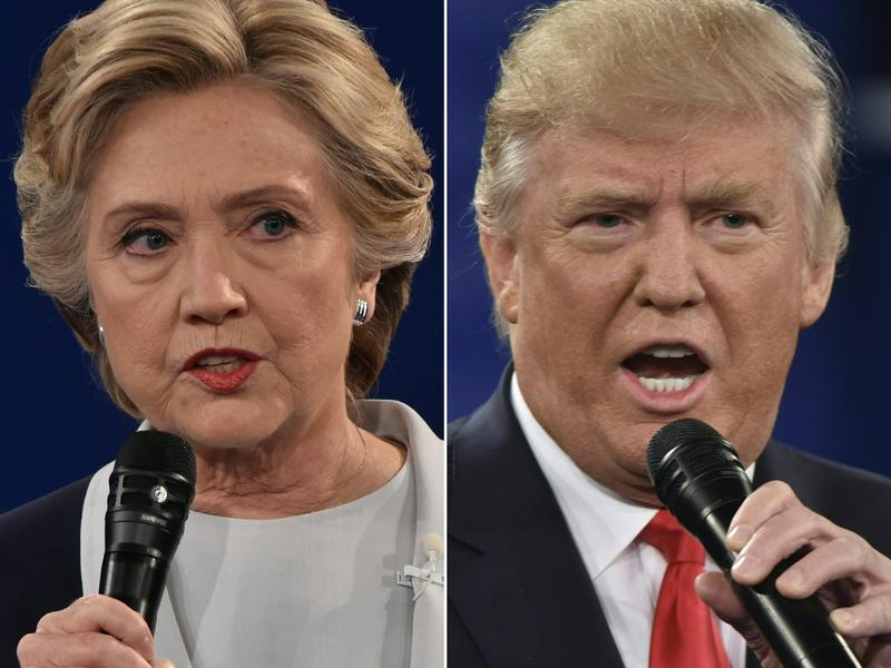 This combination of pictures created on Oct. 9, 2016 shows Democratic presidential candidate Hillary Clinton and Republican presidential candidate Donald Trump during the second presidential debate at Washington University in St. Louis, Mo. (Paul J. Richards/AFP/Getty Images)