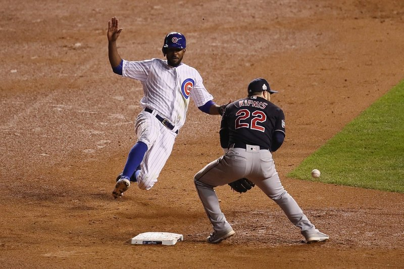 Dexter Fowler of the Chicago Cubs steals second base past Jason Kipnis of the Cleveland Indians in the seventh inning in Game 5 of the 2016 World Series at Wrigley Field on Oct. 30, 2016 in Chicago. (Ezra Shaw/Getty Images)