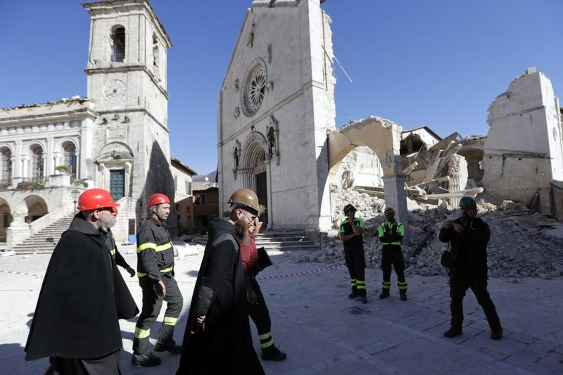 Monks walk in front of the Cathedral of St. Benedict in Norcia, central Italy, Italy, Monday, Oct. 31, 2016. (Gregorio Borgia/AP)
