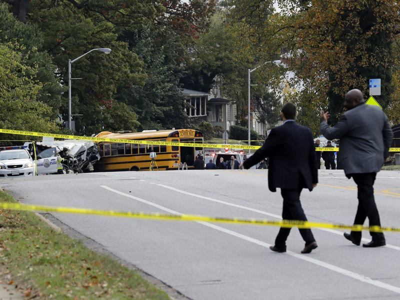 Baltimore police spokesman T.J. Smith said a school bus rear-ended a car early Tuesday morning, then struck a pillar at a cemetery and veered into oncoming traffic, smashing into a Maryland Transit Administration bus on the driver's side.