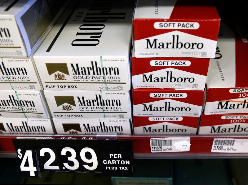 Cartons of cigarettes on shelves at Discount Smoke Shop in Ballwin, Mo., in 2012 were much cheaper than cigarettes in most other states. Missouri's tobacco tax is still only 17 cents per pack, but will rise if either of two state ballot measures passes this month.