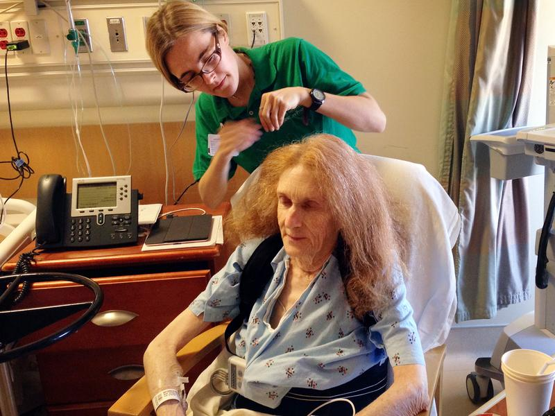 Volunteer Julia Torrano helps Estelle Day, 79, style her hair while she's a patient at UCLA Medical Center.