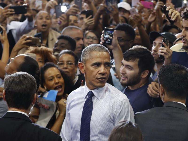 President Barack Obama campaigns for Hillary Clinton in Miami on Thursday.