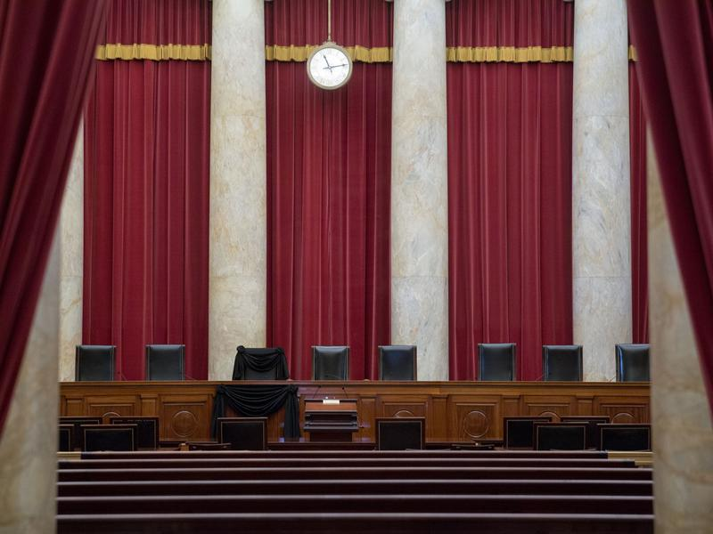 Eight out of nine chairs are seen at the Supreme Court, including one draped in black for Justice Antonin Scalia, who died in February.