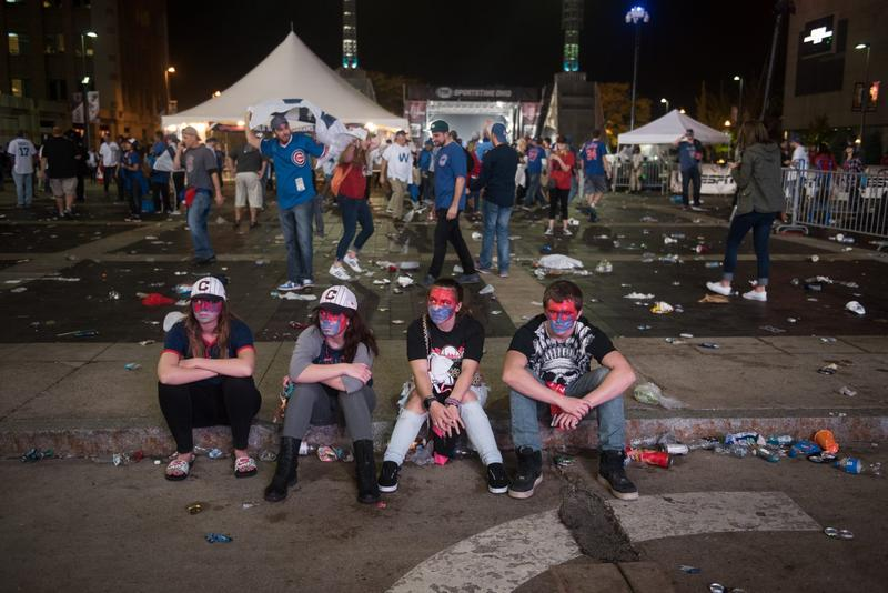 Cleveland Indians fans sit outside of Progressive Field after the Chicago Cubs beat the Indians in Game 7 of the World Series. (Justin Merriman/Getty Images)
