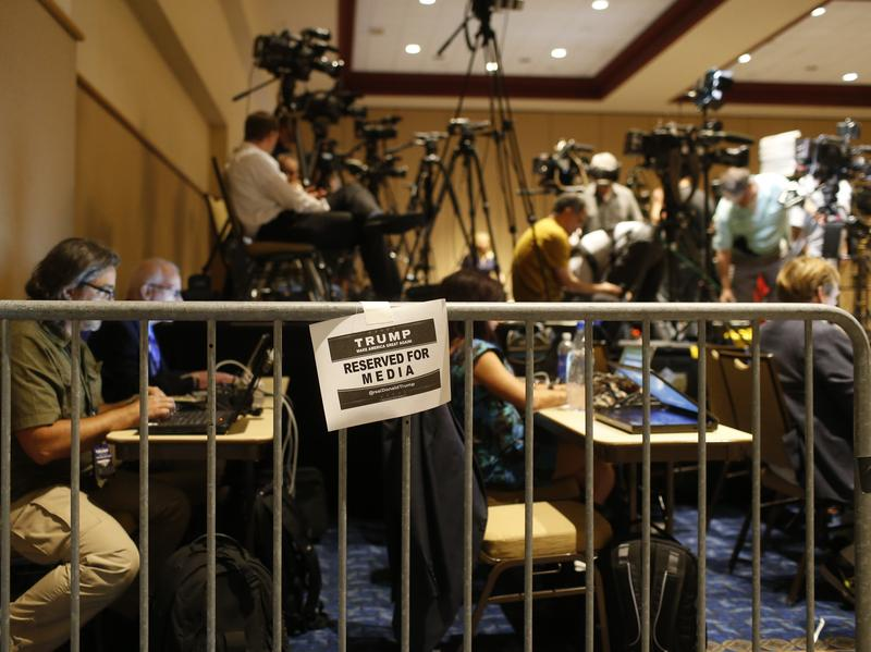 Journalists work in the Trump campaign's designated media pen as they wait for the candidate to arrive at a town hall meeting on March 14 in Tampa, Fla. Foreign journalists covering the campaign say gaining official access to Trump events has been more challenging than to Hillary Clinton's.