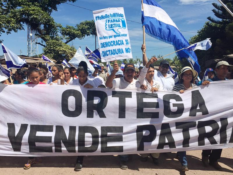 """Thousands of Nicaraguans protested last weekend against Daniel Ortega, who is running for a third term as president in Sunday's election. Critics say he has effectively eliminated all serious opposition. The banner reads, """"Ortega Sells the Homeland."""""""