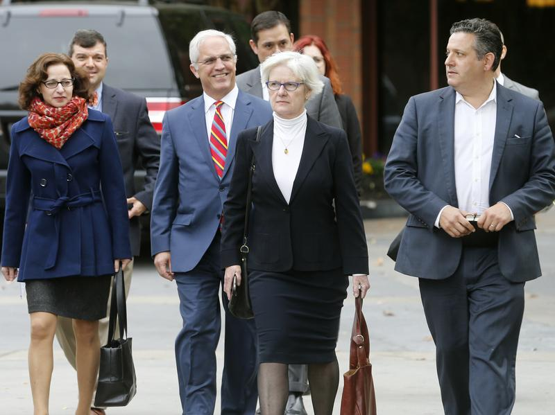 Reporter Sabrina Rubin Erdely (left) and <em>Rolling Stone</em> Deputy Managing Editor Sean Woods (far right) walk with their legal team as they head into federal court Tuesday in Charlottesville, Va.