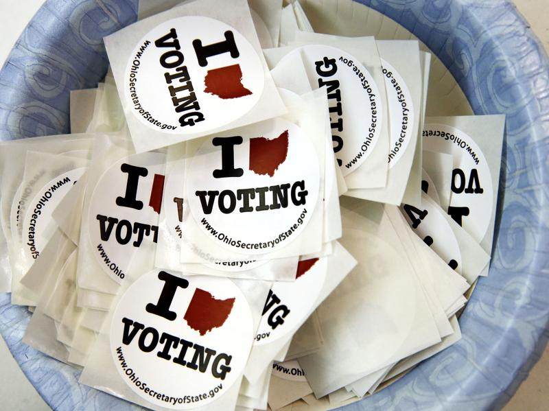 Stickers were on hand at a polling place during the primary election earlier this year in Westerville, Ohio. Friday, a judge in Ohio warned the campaigns not to intimidate voters.