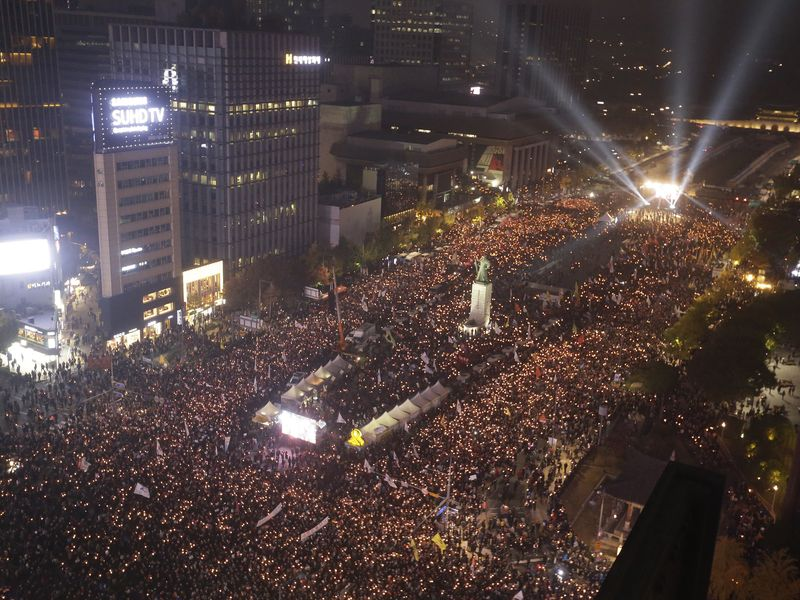 Tens of thousands of protesters flood part of downtown Seoul Saturday, calling for South Korean President Park Geun-hye to step down over an explosive political scandal.