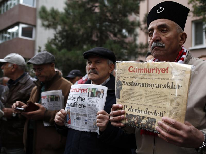 <em>Cumhuriyet</em> newspaper readers protested the government's detaining of its editor-in-chief and others this week. An Istanbul court has ordered nine of the paper's journalists to be held in prison pending trial.