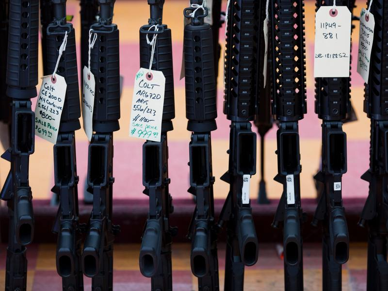 Rifles for sale at a gun shop in Merrimack, N.H. In California, gun shop owner David Strickroth says he's been selling six or seven guns a day.