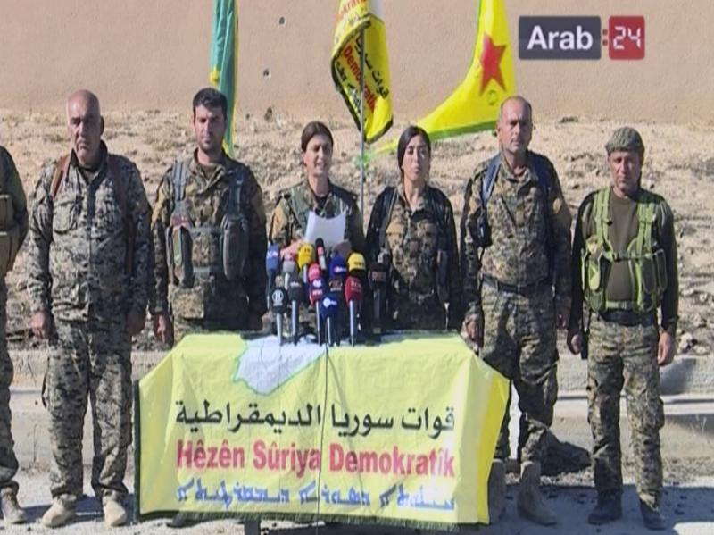 """Commanders of the U.S.-backed Syria Democratic Forces announce a campaign targeting """"obscurantists"""" — ISIS — that have claimed Raqqa as their capital. This image comes from a frame grab from the Arab 24 network."""
