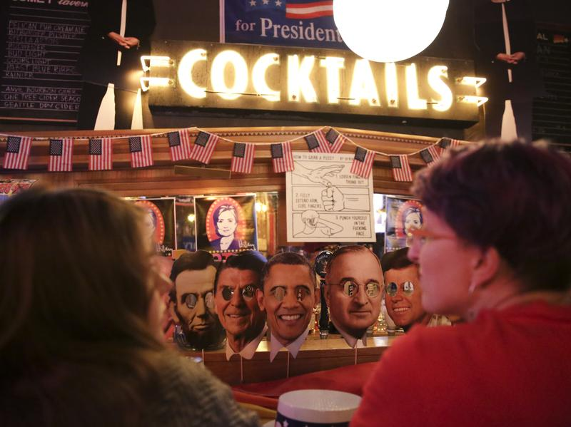 Cutouts of past U.S. presidents line the bar as Hillary Clinton supporters watch televised coverage of the presidential election at the Comet Tavern in Seattle on Tuesday.