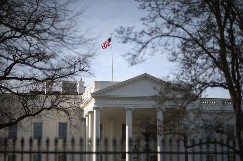 Morning sunlight strikes the flag flying above the White House March 18, 2015 in Washington. (Chip Somodevilla/Getty Images)
