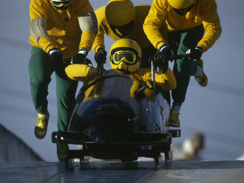 The Jamaican four man bobsleigh team in action at the 1988 Calgary Winter Olympic Games.