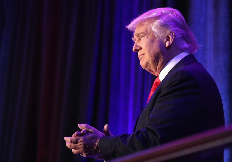 Republican President-elect Donald Trump acknowledges the crowd during his election night event in the early morning hours of Nov. 9, 2016 in New York. (Joe Raedle/Getty Images)