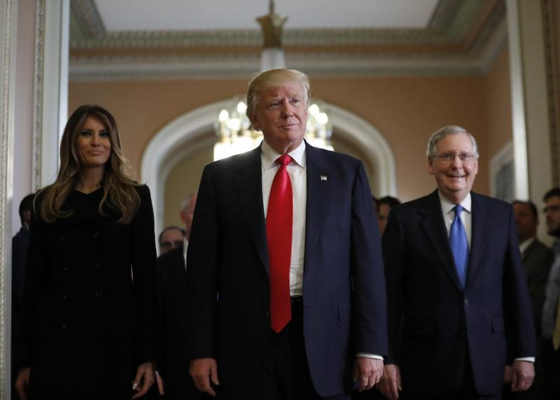 Melania Trump, and her husband President-elect Donald Trump, center, walk with Senate Majority Leader Mitch McConnell, of Kentucky, as they depart after a meeting on Capitol Hill, Thursday, Nov. 10, 2016 in Washington. (Alex Brandon/AP)