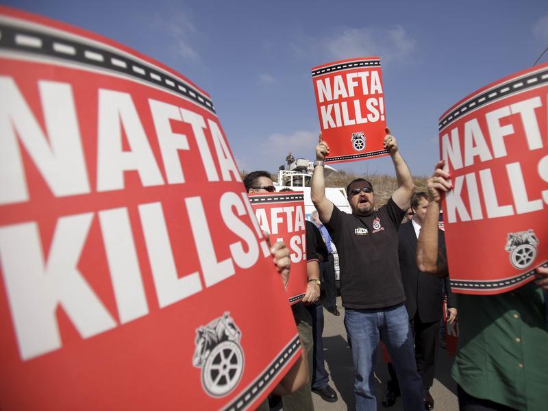 Teamsters union members in San Diego rail against the NAFTA trade deal in 2011.